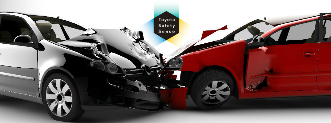 Gray and Red Car in Crash with Toyota Safety Sense Logo in Background