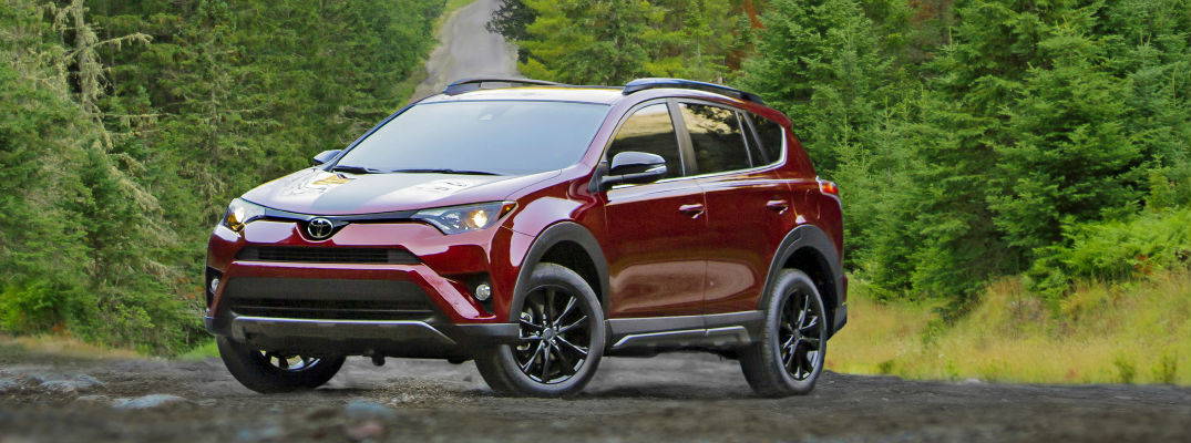 Red 2018 Toyota RAV4 Adventure on Wooded Road