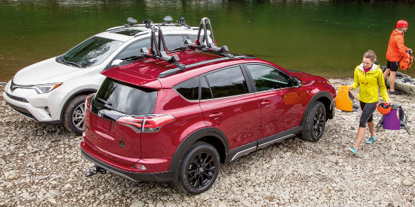 Overhead View of Ruby Flare Pearl 2018 Toyota RAV4 Adventure and White RAV4 XLE Next to River