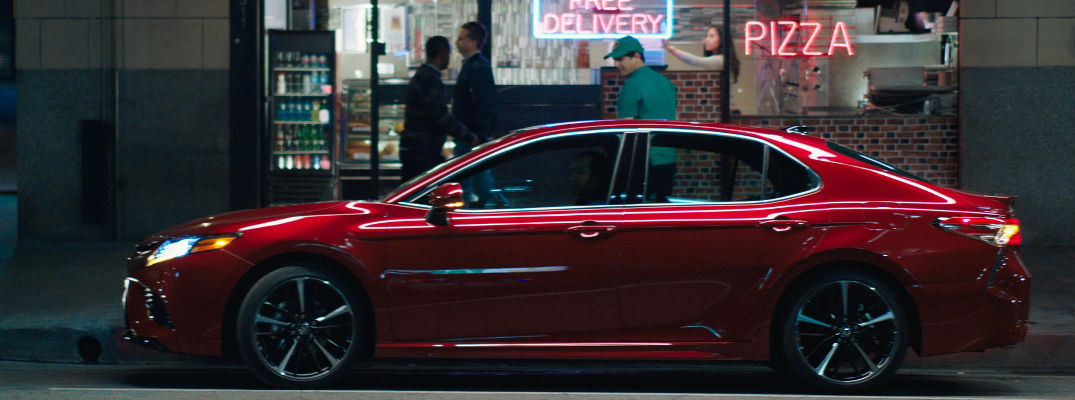 Red 2018 Toyota Camry Side Exterior in Front of Pizza Parlor
