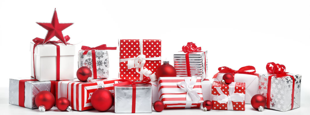 Pile of Christmas Gifts in Red and White Wrapping Paper with Red Ornaments on White Background