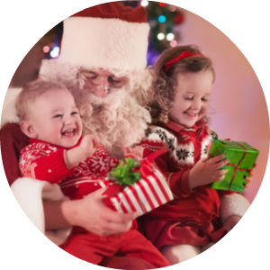 Santa Claus with Little Boy and Girl on His Lap Holding Presents
