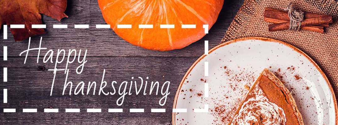 Overhead View of Table with Pumpkin Pie and Small Orange Gourd with White Happy Thanksgiving Text