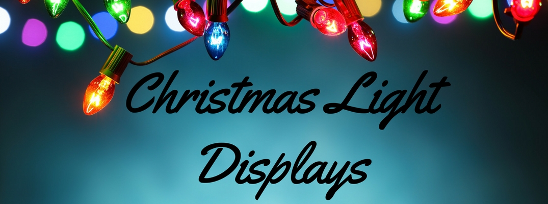 Blue Background with Colorful String of Christmas Lights and Black Script that Reads Christmas Light Displays