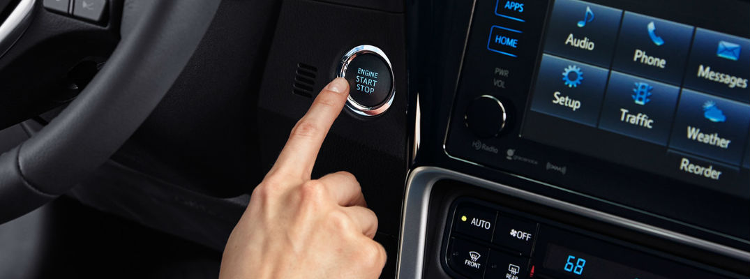 Close Up of Finger Pressing Engine Start/Stop Button in 2018 Toyota Corolla