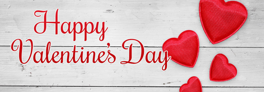 Red Happy Valentine's Day Text and Red Hearts on White Wood Background