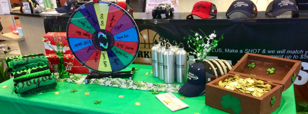 Picture of the Prize Wheel and Table at Toyota of Hattiesburg Lucky Leprechaun Madness Sale