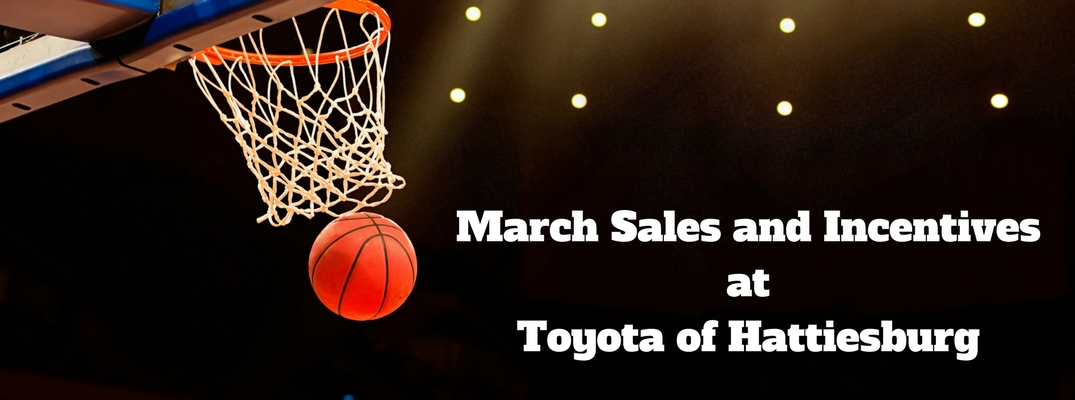 Basketball Going Through Hoop in an Arena with White March Sales and Incentives at Toyota of Hattiesburg Text