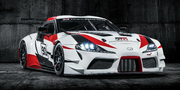 Red, White and Black Toyota GR Supra Concept Front Exterior on Black Background