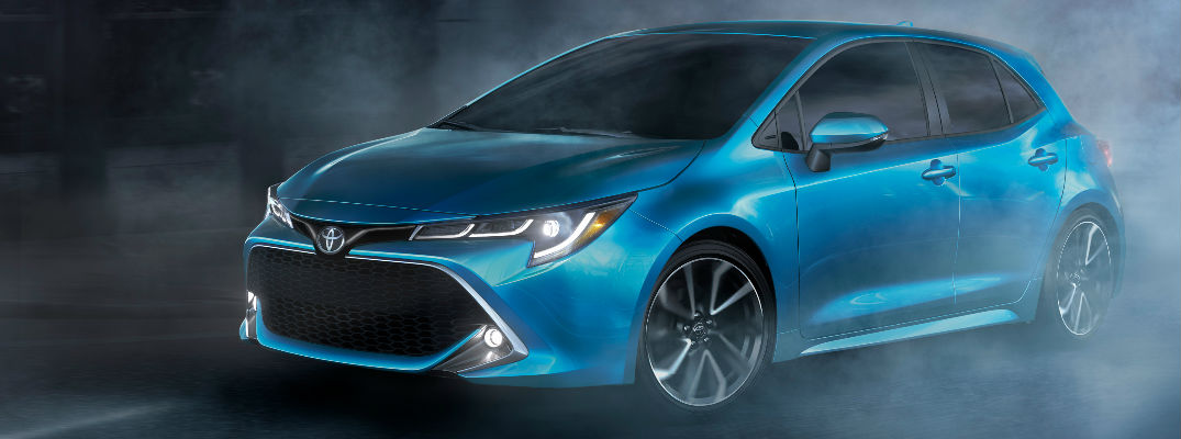 Blue 2019 Toyota Corolla Hatchback Front Exterior on Blacktop with Mist