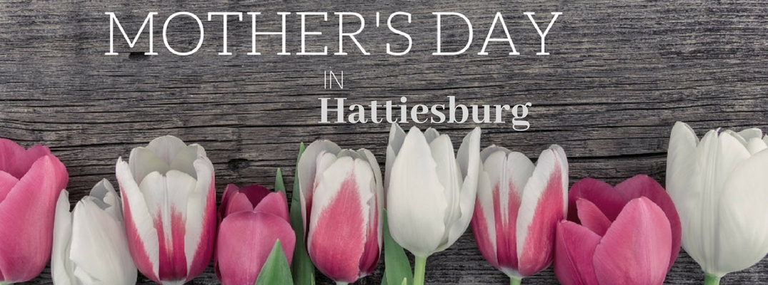 Pink and White Tulips on a Dark Wood Background with White Mother's Day in Hattiesburg Text