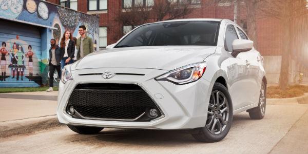 White 2019 Toyota Yaris Sedan Front Exterior on a City Street