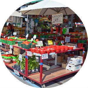 Tents, Umbrellas and Fresh Produce at a Farmers Market
