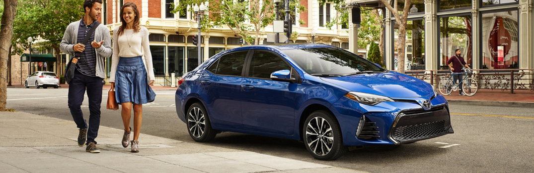 blue 2019 corolla parked with couple walking