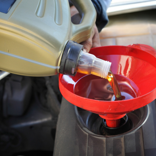 adding new oil to a car