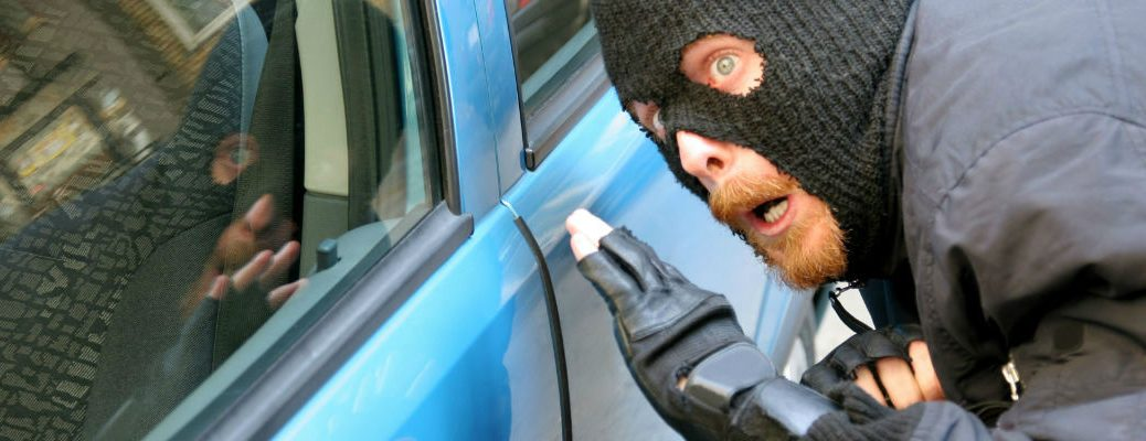 burglar breaking into car